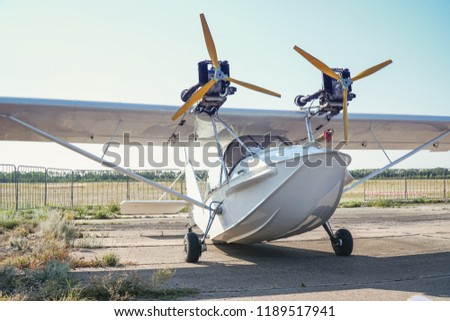 Light twin-engine amphibious aircraft at the airport. Front view