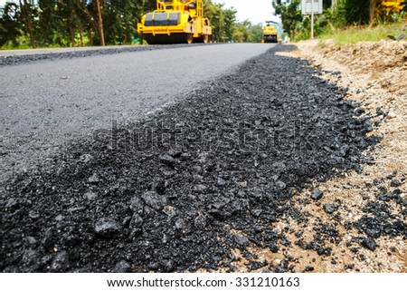 Light Vibration roller compactor at road under construction and repairing asphalt, Road making.