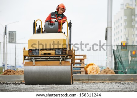 Light vibration roller compactor at urban road construction and repairing asphalt pavement works
