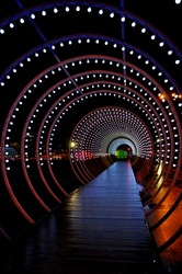 Light way Christmas Holiday Circle and tunnel of lights. Platform of lights. Stars alien Night colours