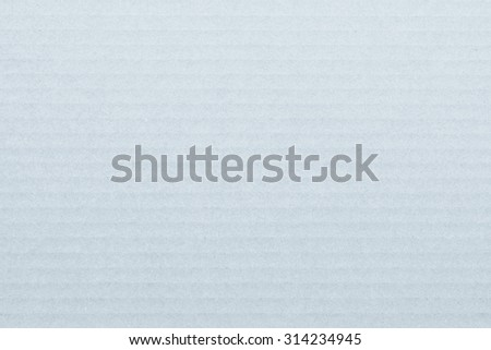 Light white grey blue color tone corrugated cardboard paper texture patterned background: Recycled cardboard textured pattern grunge detailed backdrop in light pastel selenium grey toned colour