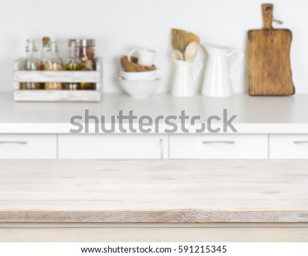 Light wood table with bokeh image of kitchen counter interior. #591215345