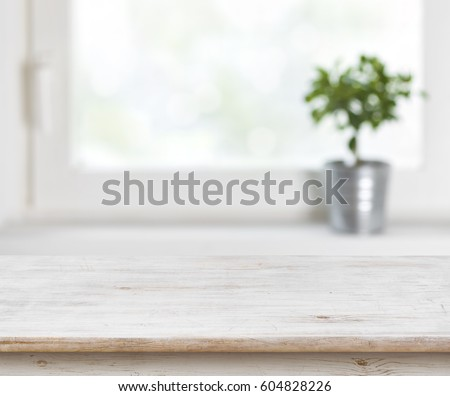 Light wooden texture table on defocuced summer window background. #604828226