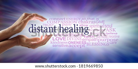 Light worker sending high frequency distant healing word  cloud concept - cupped hands with white light between and a DISTANT HEALING word cloud against an outward streaming blue energy field   Stock photo ©