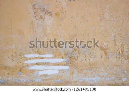 Light yellow rough stucco background in the daytime #1261495108