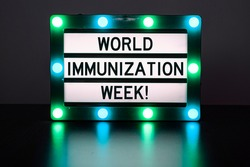 Lightbox with green lights with words - World immunization week!