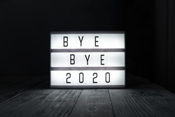 Lightbox with text BYE BYE 2020 in dark room. Hope, new life and Happy New Year 2021 concepts - Image