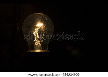 lightbulb on black background #454234909