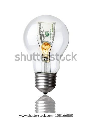 Lightbulb with burning dollar inside on white