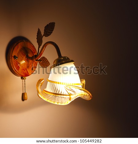 Lighted classic sconce on the wall