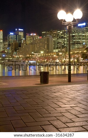 lighted Darling Harbour at night vertical photo, Sydney, Australia