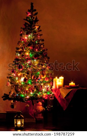 Lighted decorated Christmas tree in living room #198787259