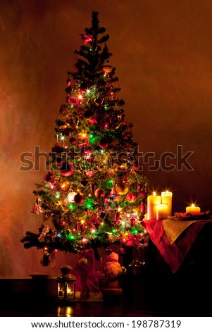 Lighted decorated Christmas tree in living room #198787319