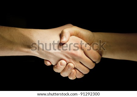 Lighted two hands unite with eachother as agreement
