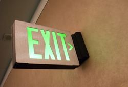 Lighted Wall Mounted Exit Sign Shows People Way Out Public Building