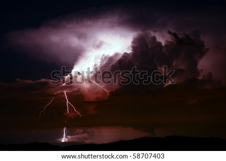 Lightening and storm over hills in the night
