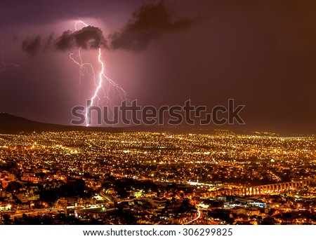 Lightening strike over the city of Queretaro Mexico. In this picture you can see can clearly Los Arcos a historic landmark of the historic town.