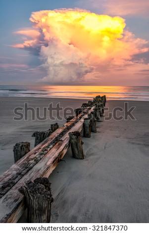 Lightening strikes off the Atlantic Coast from a passing thunderstorm at Folly Beach in Charleston South Carolina.