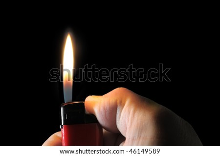 lighter in hand isolated on a black
