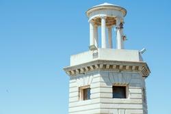 lighthouse against blue sky in Venice, Italy.