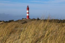 Lighthouse amidst marram grass and sand dunes in Amrum, North frisian island in Schleswig Holstein, Germany