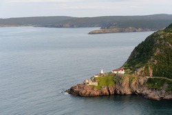 Lighthouse and artillery ruins of Fort Amherst as viewed from Signal Hill in St. John's, Newfoundland