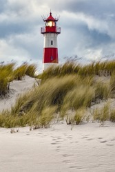Lighthouse and beach grass on a windy day