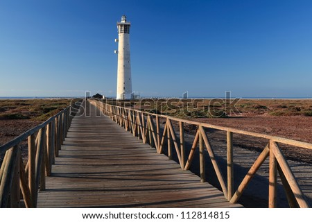 lighthouse and marshes in fuerteventura island near the beach