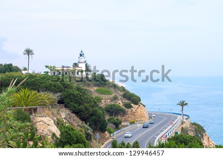 Lighthouse and road on Costa Brava coast.