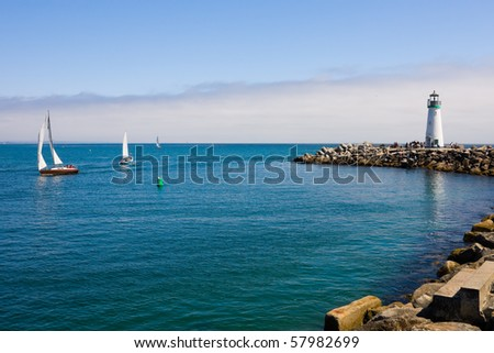 Lighthouse and sail boats