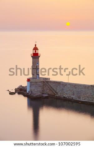Lighthouse and sun, Bastia port, Corsica, france