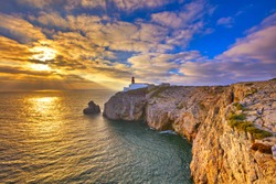 Lighthouse at Cabo de Sao Vicente, Algarve, Portugal. The lighthouse is situated on the tip of the Cape of St. Vincent, the extreme southwesternmost point in Europe.