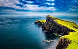 Lighthouse at edge of sea cliff. Sea  coastal cliff landscape. Coastal cliss view