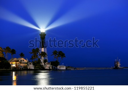 lighthouse at hillsboro florida beaming before dawn, three composite exposures