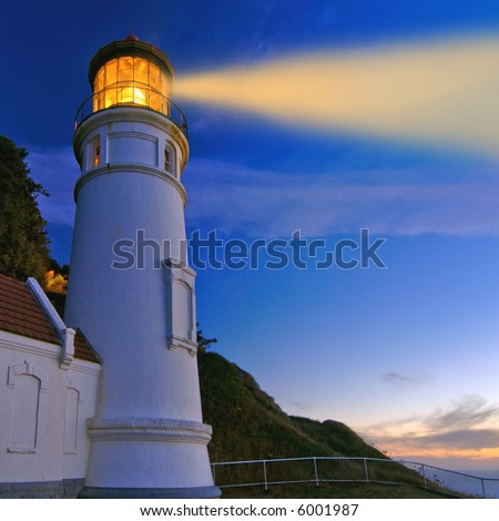 lighthouse at night with beam enhanced