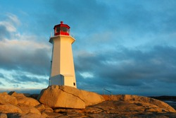 Lighthouse at Peggys Cove at Sunrise, Nova Scotia, Canada. Peggys Cove Lighthouse is an active lighthouse and an iconic Canadian image