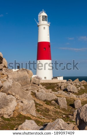 Lighthouse at Portland Bill with blue sky, England.