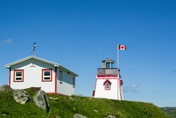 Lighthouse, at St. Anthony's, Newfoundland, Canada, called Fox Point Light station, located in Fishing Point Park over looking the Harbor of St, Anthony's