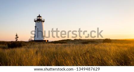 Lighthouse at sunrise #1349487629