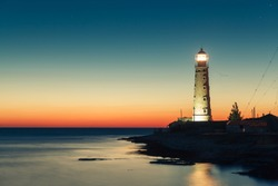 lighthouse at sunset in the twilight in clear weather at Cape Tarkhankut in Crimea