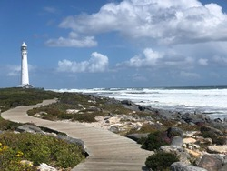 Lighthouse, Cape Town, SA. Beautiful scenic view of costal path leading to lighthouse