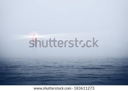 Lighthouse in a foggy sea