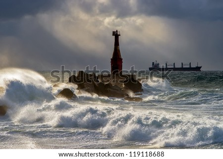 Lighthouse in a storm. Kholmsk.