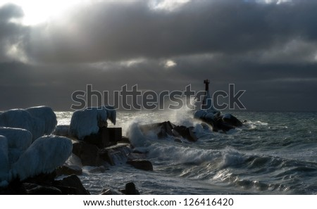 Lighthouse in a storm. Kholmsk. Sakhalin.