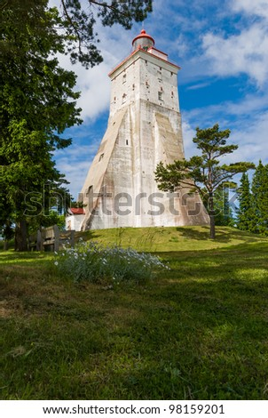 lighthouse in estonia, sunny day fresh green - stock photo