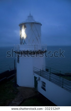 Lighthouse in evening mist