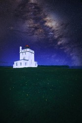Lighthouse in Iceland with milky way