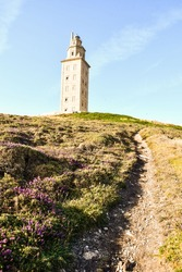 lighthouse in mountains, photo as a background , in a coruna north spain, galicia, spain, europe , tower of hercules lighthouse