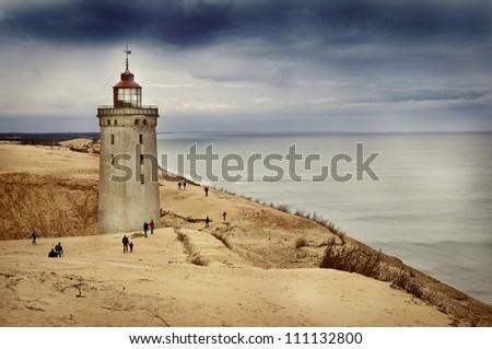 Lighthouse in Rubjerg Knude, Denmark, in autumn weather