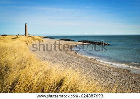 Lighthouse in Skagen, Denmark, on a sunny day #624887693